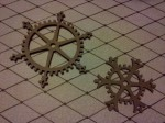 Two snowflake gears made of cardboard