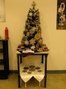 A small Christmas tree covered with steampunk gear ornaments