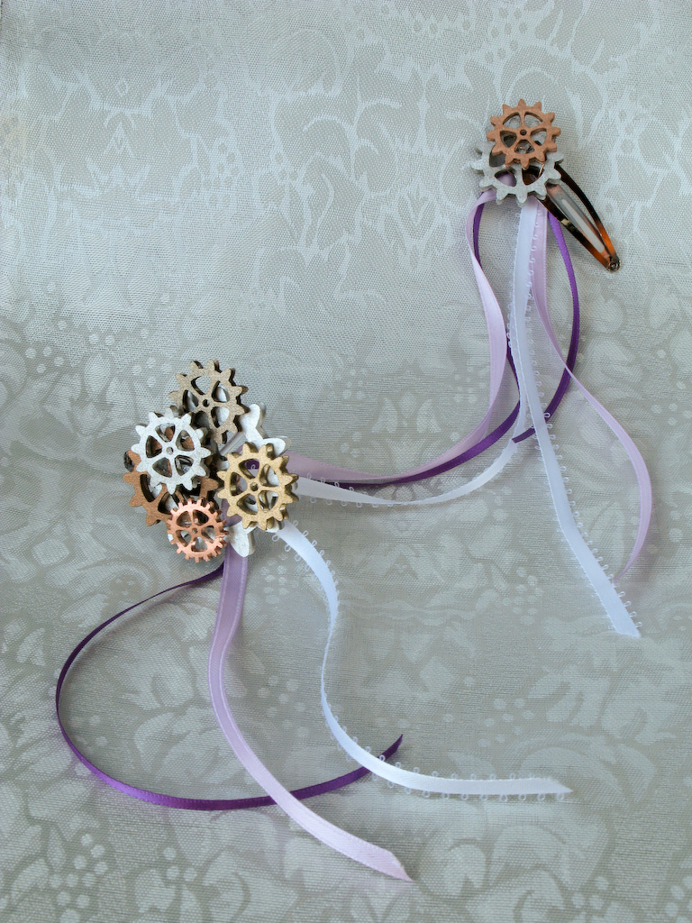 Pair of gear cluster hair clips connected by ribbons
