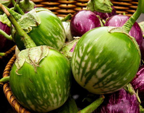 Green and white Thai eggplants in basket